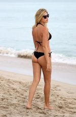 Lada Kravchenko In a black string bikini on the beach in Miami