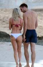 Laura Anderson and Max Morley enjoy a beach day in Barbados