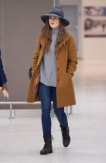 Lily Collins Arrives at JFK airport in New York