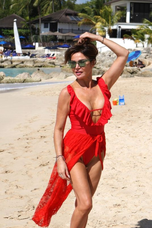 Lizzie Cundy In all red on the beach in Barbados during a winter break