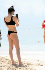 Lottie Moss Flaunts her model figure in a tiny red bikini in Barbados
