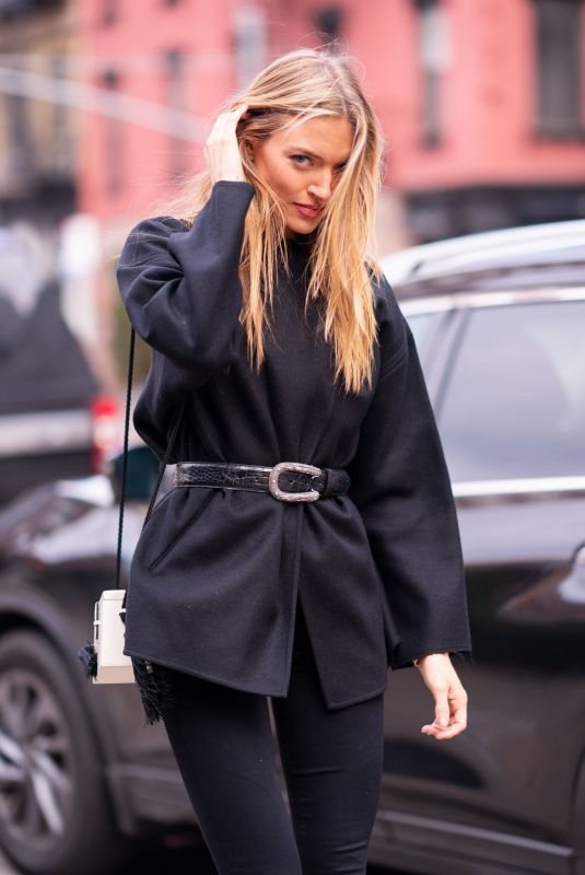 Martha Hunt Wearing an Isabel Marant top, Paige jeans with a Hunting Season handbag in Tribeca in New York City