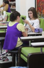 Olivia Jade Giannulli Checks her cell phone while getting her nails done int he 90210 in Beverly Hills