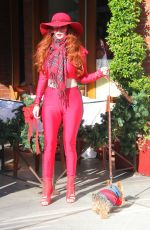 Phoebe Price Displays her Christmas ready outfit while out with her pooch in Beverly Hills
