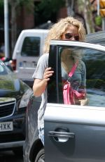 Shakira In casual attire wearing ripped jeans shorts in Barcelona