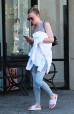 Dakota Fanning Works up a sweat at the gym in LA
