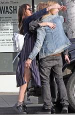 Dakota Johnson With her brother Jesse and her sister Grace before going shopping and getting cozy in Hollywood