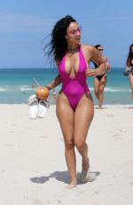 Draya Michele In a pink swimsuit poolside in Miami