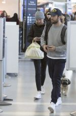 Emily VanCamp and Josh Bowman share a kiss in Toronto