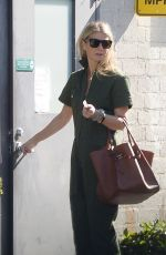 Gwyneth Paltrow Chats with a Friend on Her Way to a Business Meeting in Los Angeles