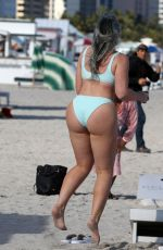Iskra Lawrence in a light blue bikini at the beach in Miami