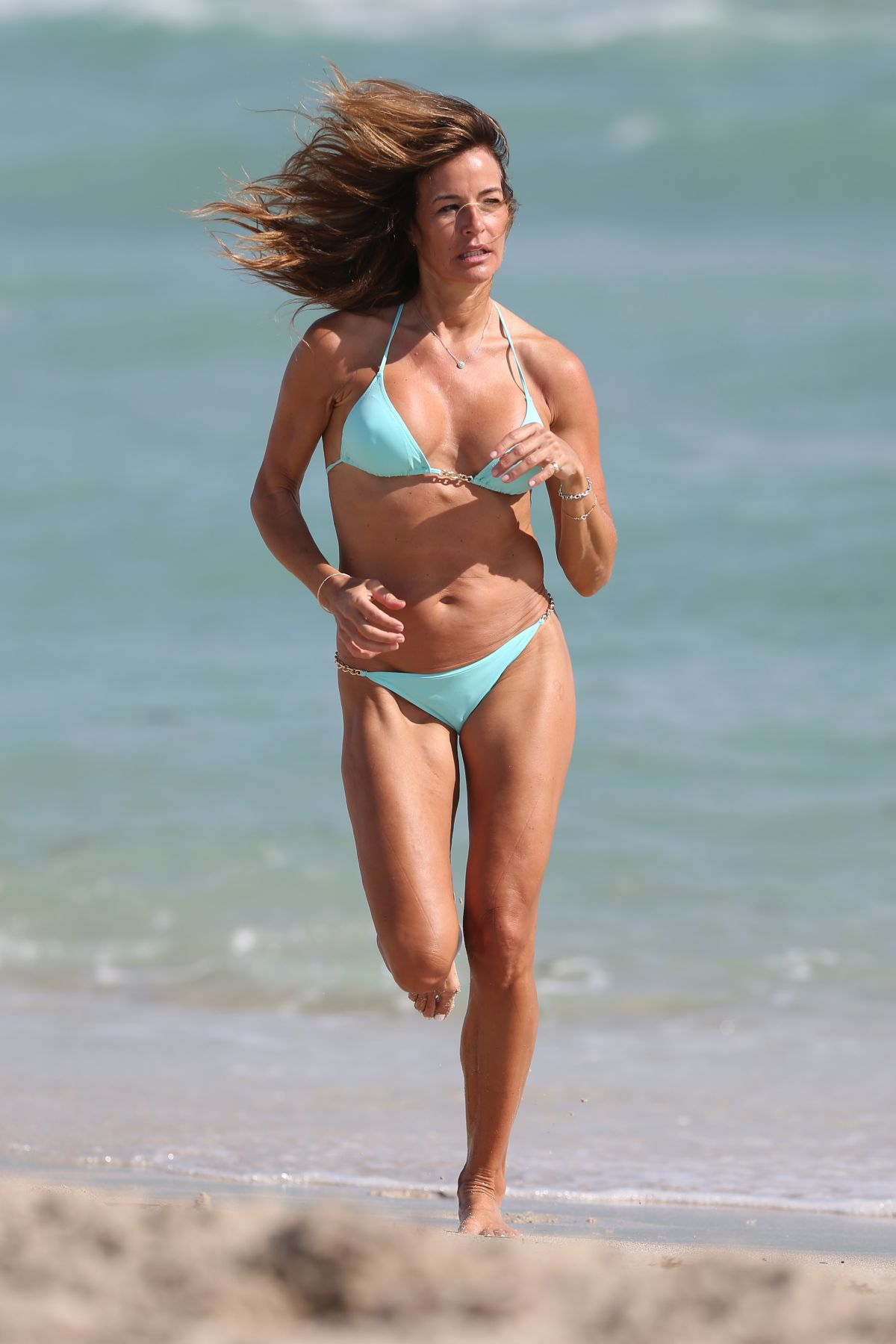 69cc8bdb8b595b Kelly Bensimon In a Elizabeth Hurley Swim sea green bikini on New Years Eve  on Miami Beach