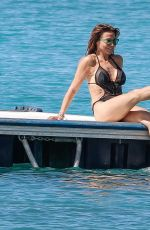 Lizzie Cundy In a tiny black swimsuit on the beach in Barbados