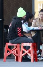 Madison Beer Has a conversation with friends while getting ice cream in LA