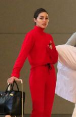 Olivia Culpo Stands out in a bright red ensemble as she arrives to LAX with her sister in Los Angeles