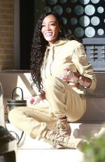Winnie Harlow Poses with a new Louis Vuitton bag in front of Barneys New York