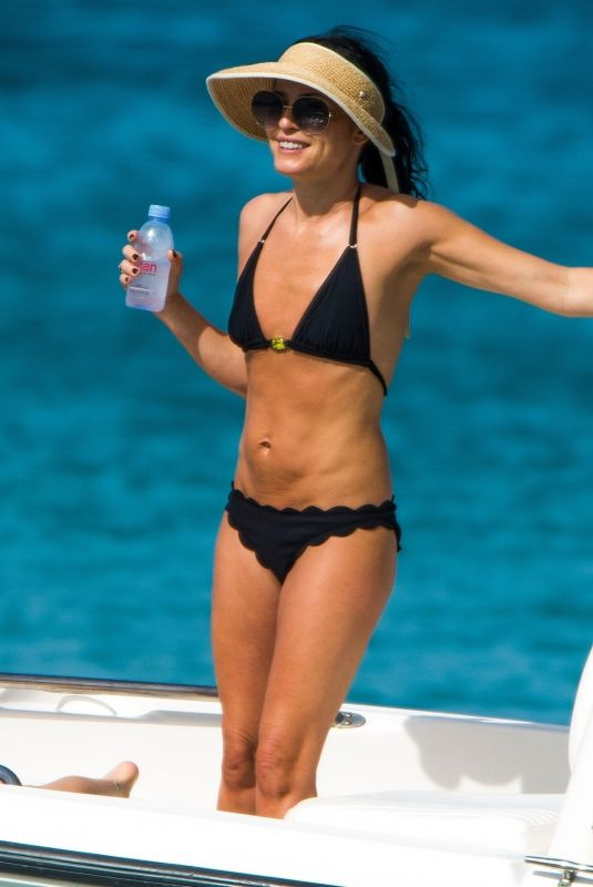 Andrea Corr and her family enjoy a day on the beach in Barbados