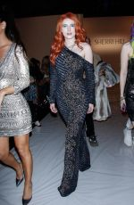 Bella Thorne Shines in skin tight body suit as she attends Sherri Hill Fashion Show in NYC