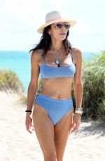 Bethenny Frankel In a blue bikini as she relaxes by the pool with boyfriend Paul Bernon in Miami