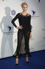 Charlize Theron At Cinema For Peace International Committee & Nominee Dinner in Berlin, Germany