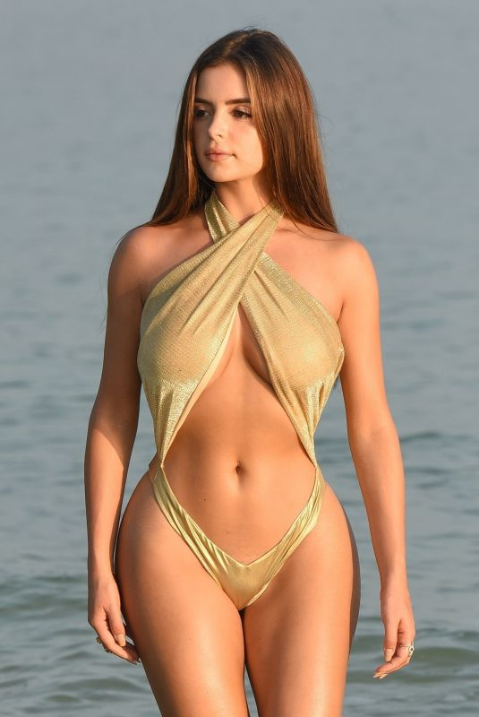 Demi Rose Wearing a gold one piece on a remote island in Phuket