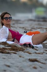 Giada De Laurentiis Wears a pink swimsuit as she relaxes on the beach in Miami