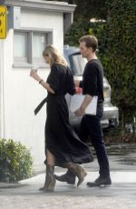 Gwyneth Paltrow Heads to a business meeting with an assistant in Los Angeles