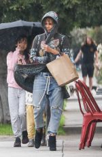 Halle Berry Heads to Erewhon Natural Foods under the rain in Los Angeles