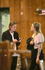 Ireland Baldwin Gets cozy with Corey Harper while out with friends in West Hollywood
