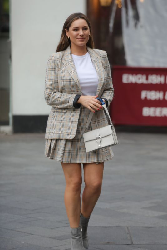 Kelly Brook With Mini-Skirt and Matching Top arriving Global Radio in London