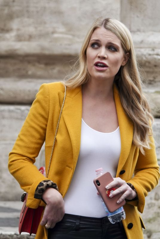 Kitty Spencer Wearing a yellow coat while in Rome with some friends