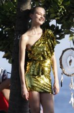 Martha Hunt Posing for photoshoot in a stunning gold sequin dress on the streets of Ipanema