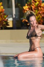 Megan McKenna Sunbathing by the pool while in Tenerife