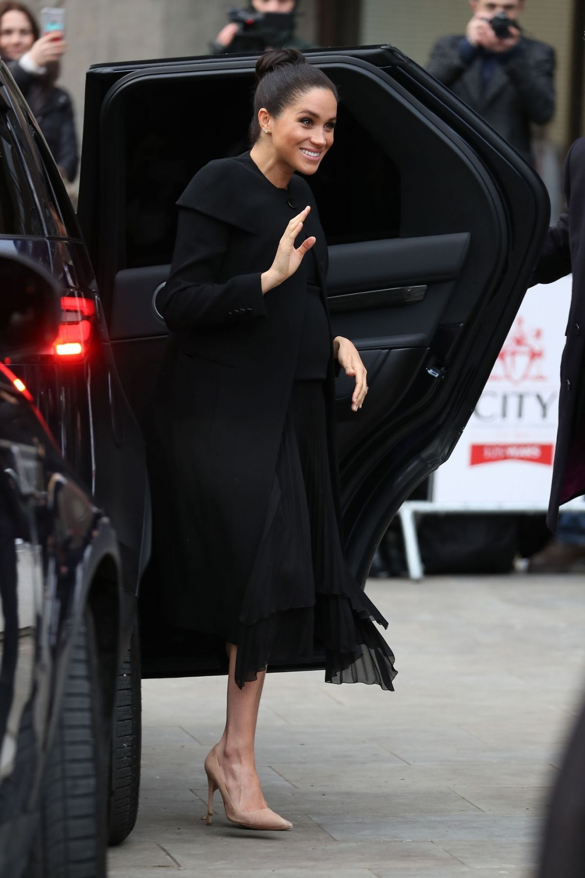 meghan  duchess of sussex visits the association of