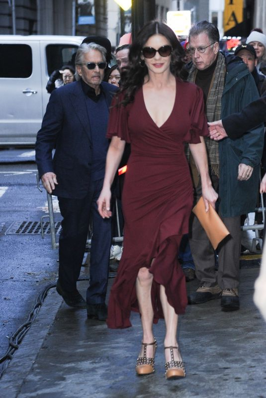 Michael Douglas and Catherine Zeta-Jones leave Michael Kors fashion show with their daughterin New York