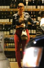 Nicole Murphy and Carmelo Anthony exit Wally