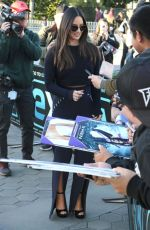 Olivia Munn Greeting fans as she films for Extra in Universal City, California