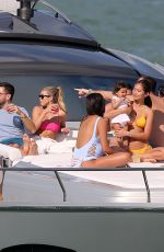 Sofia Richie Wears a hot pink bikini top on a yacht in Miami