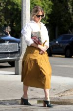 Alice Eve Looks fashionably chic as she tends to some light business in West Hollywood
