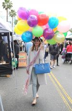 Allison Janney Cheerfully shops for balloons at the Farmer