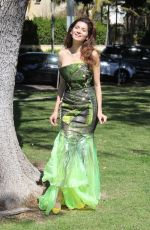 Blanca Blanco In green for a photoshoot at the park
