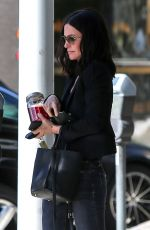 Courteney Cox Crosses the street after attending a business meeting in Beverly Hills