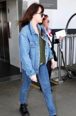 Dakota Johnson Donned a denim jacket and jeans for her flight into Los Angeles
