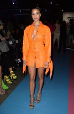 Draya Michele Stuns in orange leather at the Christian Cowan PowerPuff Girls Fashion Show in Los Angeles