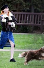 Eleanor Tomlinson Playing with her dog at the Park in London