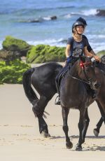 Elsa Pataky Horse riding on a beach in Byron Bay