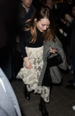 Emily Browning Arrives at the Royal Monceau Hotel during Fashion Week in Paris, France