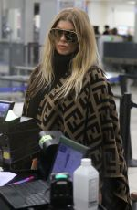 Fergie Rocks a Fendi poncho for a flight out of LAX Airport in LA