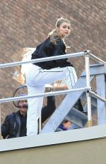 Gigi Hadid On a photoshoot for Maybelline on a rooftop in NYC