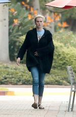 Ireland Baldwin Focuses on her phone after walking her dog at a local dog park in LA